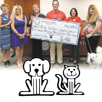 Roger D. Eaton, Clerk of the Circuit Court and County Comptroller presents Animal Welfare League with donation check